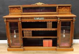 A Victorian gilt metal mounted walnut and marquetry library side cabinet, the shallow back with a