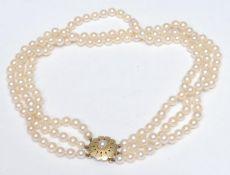 A cultured pearl three strand choker necklace, three uniform strands of creamy white cultured