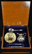 A 19th century Continental silver-gilt cream jug and sugar basin, possibly Russian, chased with