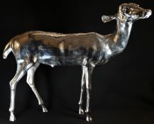 An imposing silver plated cast floor standing model, of a doe deer, 59cm high, 69cm wide, 20th