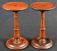 A pair of George IV rosewood circular candle stands, shallow galleries, turned pillars and bases,