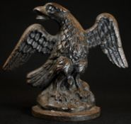 A 19th century cast iron door stop, as a spread eagle, 21cm wide