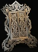 A 19th century EP novelty easel photograph frame, as an elaborate doorway, the bi-partite doors