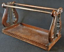 A 19th century Anglo-Indian hardwood book carrier, lyre-shaped end supports carved with scrolling