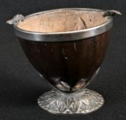 A 19th century coconut cup, the silver plated base cast with lotus, the rim applied with vine
