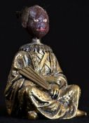 A 19th century Chinoiserie gilt bronze and composition novelty glue pot, cast as a Chinese man,