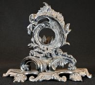 A 19th century Rococo Revival silver plated pocket watch stand, cast throughout with scrolling