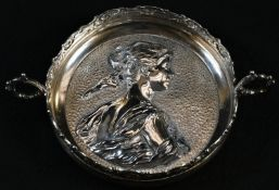 A 19th century Rococo Revival silver-plated twin-handled circular dish, the centre boldly cast in