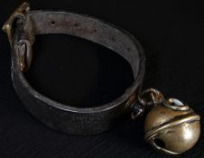 A 19th century leather animal collar, with brass crotal or rumbler bell, 16cm diam