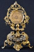 A 19th century French Rococo Revival gilt metal pocket watch stand, pierced and cast throughout with