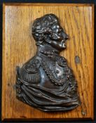 A 19th century brown patinated bronze portrait plaque, of Arthur Wellesley, 1st Duke of