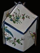 A 19th century French faience octagonal sugar box, painted in the Japonesque taste with