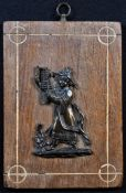 A 19th century dark patinated bronze chinoiserie appliqué, cast as a Chinese figure, oak mount, 17.