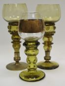 A near pair of 19th century German Hock glasses, green tinted bowls, multi stepped blown hollow