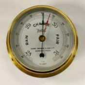 A Sestrel ship;s bulkhead barometer, Henry Browne and Sons Limited, Barking, Essex, brass case, 11cm