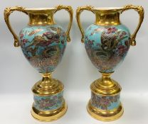 A pair of large late Victorian/Edwardian English pottery twin handled vases and stands, decorated