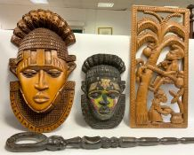 Tribal Carvings - a Nigerian carved wooden Warrior wall mask, inset with brass forehead design,