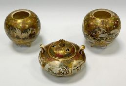 A pair of Japanese Satsuma pottery globular vases, each decorated with traditional figure panels