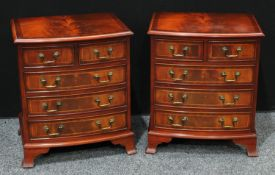 A pair of a George III style crossbanded mahogany bow fronted bachelor?s chests.(2)