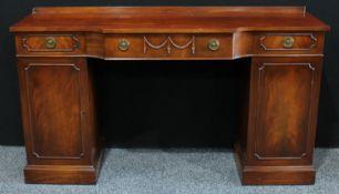 A George III style mahogany pedestal sideboard, in the Adam Revival taste,168cm wide, 93cm high.