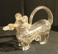 A late 19th/early 20th century novelty glass decanter in the form of a dog with stopper, 30cm long