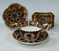 A Royal Crown Derby 1128 Imari pattern teacup and saucer; Royal Crown Derby 1128 Imari pattern pin