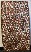 Tribal Art - an Asmat rectangular panel, carved and decorated in earth and white pigments with