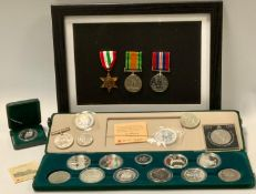 Coins & medals - a WWII trio of medals including War medal, The Defense medal and The Italy Star,