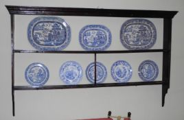 An 18th century oak open plate rack, with moulded cornice, two shelves and hooks, 11cm high, 180cm