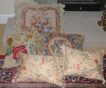 A pair of silk cushions, in yellow; others, tapestry
