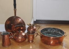A 19th century copper roll top two handled pan, 51cm diam, c.1850; a copper warming pan; etc