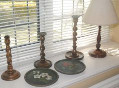 An oak barleytwist candlestick, c.1930; others; side lights; two circular wooden plates, painted