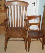 A 20th century beech kitchen elbow chair, slat back, turned legs; an elm kitchen side chair (2)