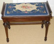 A late 19th century mahogany piano stool, with tapestry top, cylindrical legs, H stretcher, 50cm