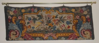 A Victorian woolwork tapestry, embroidered with birds, 70cm wide, 33cm high, c.1870