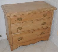 A Victorian pine chest, of three long drawers, shaped apron, 77cm high, 90cm wide, 46cm deep, c.1870