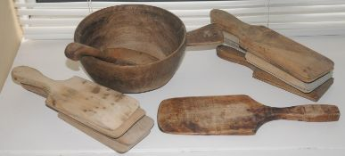 An 18th century sycamore bowl, with handle, 19.5cm diam; a ladle; various butter pats
