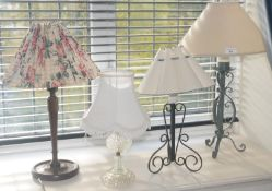 A wrought iron side lamp, 58cm high; another; etc (4)
