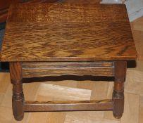 An oak stool, hinged top, 37cm high, 20th century