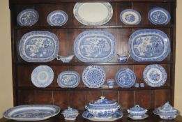 A large 19th century Staffordshire blue and white Willow pattern meat plate, 56cm wide, c.1870;