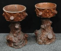 A pair of late Victorian stoneware planters/jardiniere and stands, each naturalistically modelled as