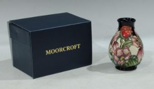A contemporary Moorcroft baluster vase, applied with roses and irises,14cm, boxed