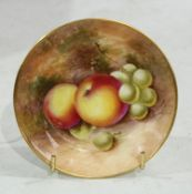 A Royal Worcester circular pin dish, painted with ripe fruit on a mossy ground, 10cm diameter