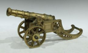 An 18th century style brass model cannon, 45cm long