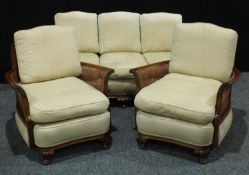 A Queen Anne style mahogany bergere drawing room suite, comprising a three seater and two single