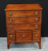 A George III style mahogany side cabinet in the form of a chest of drawers, crossbanded