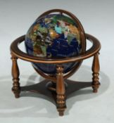 A desktop globe inset with geological specimens and mother of pearl, approximately 23cm high