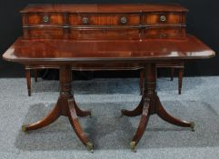 A reproduction Regency style twin pedestal mahogany dining table, rounded rectangular top, reeded