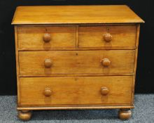 A Victorian pine chest of drawers, oversailing rectangular top above two short and two long