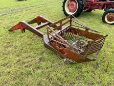 A front end loader with beet/ root bucket to fit an International tractor